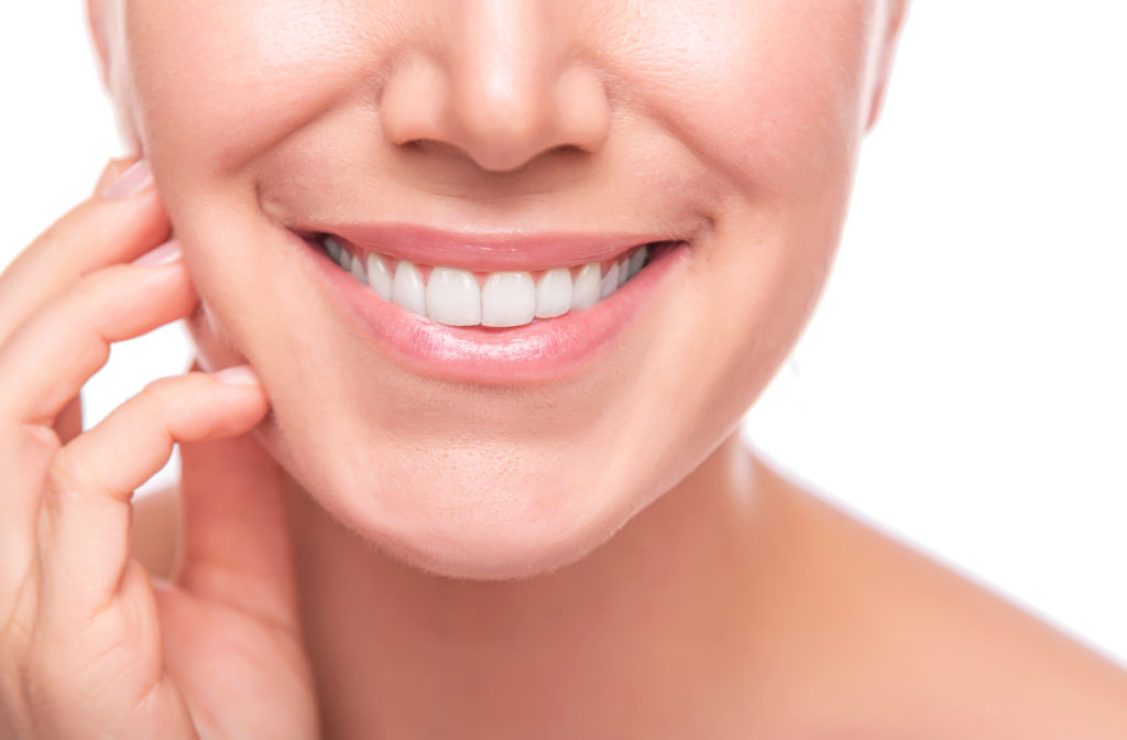 Happy women smiling with whitened teeth